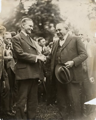 Coolidge, Calvin shaking hands with Thompson, Carmi.jpg