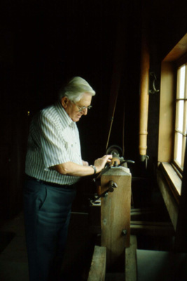 File:Sauder, Erie J. working at his lathe.jpg