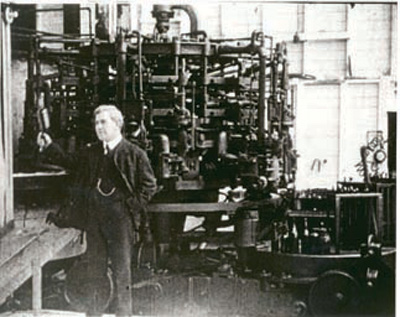 File:Owens, Michael J. in front of a Automatic Glass-bottle Making Machine.jpg
