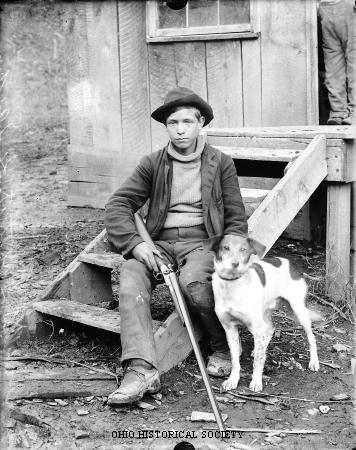 File:Boy with Gun and Dog.jpg