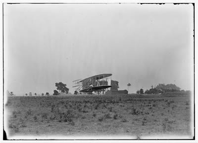 File:Wright, Orville piloting (LC).jpg